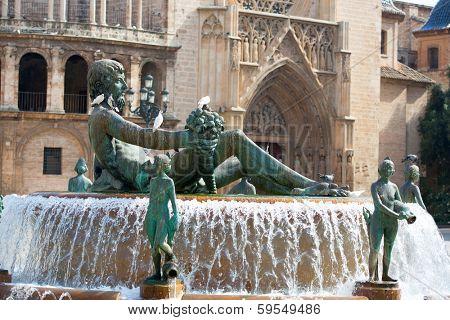 Valencia Plaza de la virgen square with Neptuno fountain and Cathedral at Spain