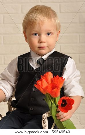 Young blond man in with flowers