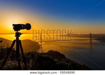 Golden Gate Bridge San Francisco sunrise California USA with photo camera silhouette