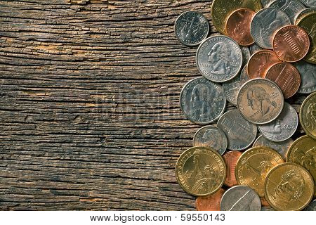 the U.S. coins on old wooden background