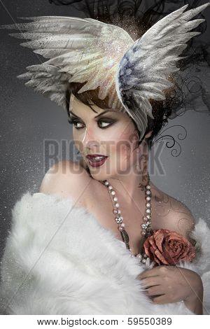 Art concept, beauty fashion portrait, brunnette with head wings