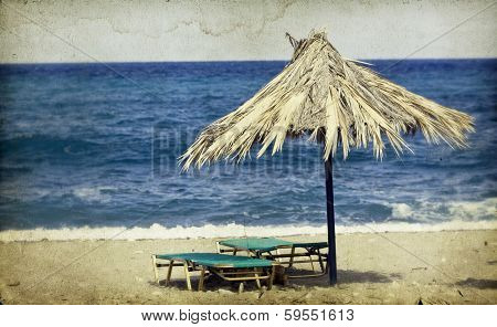 Vintage photo of chairs and umbrellas on the beach