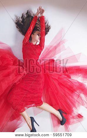 Portrait of a beauty brunette in red dress