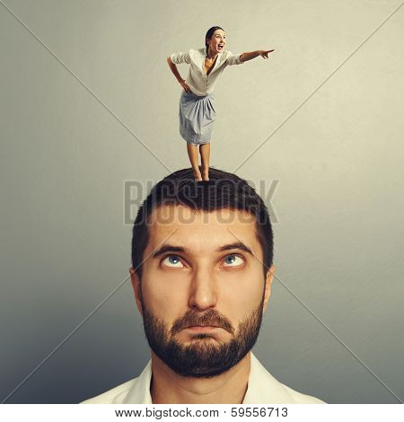 excited woman standing on the head and pointing