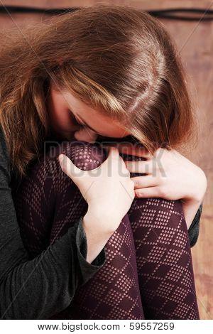 Sad or depressed woman sitting on the flor