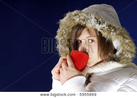Young Woman Drinking Hot Drink