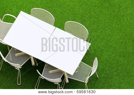 Outdoor chair and table on lawn
