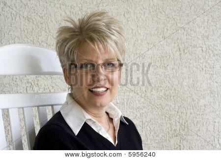 Mature Woman in Rocking Chair