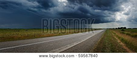 Country road and thunderstorm on a background