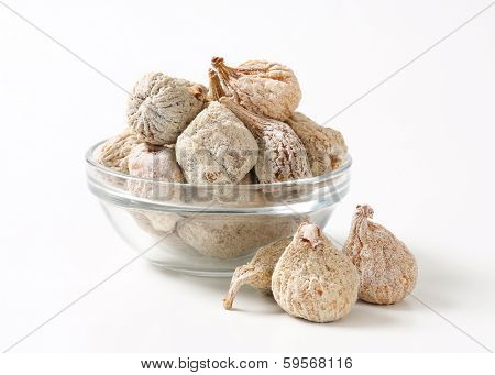 portion of dried figs served  in a glass bowl