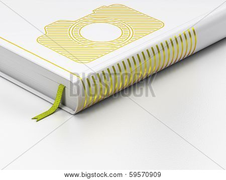 Travel concept: closed book, Photo Camera on white background