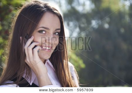Girl call phone and smile in autumn park
