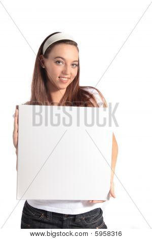 Young woman holding white board