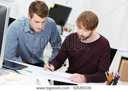 Two Dedicated Businessman Having A Meeting