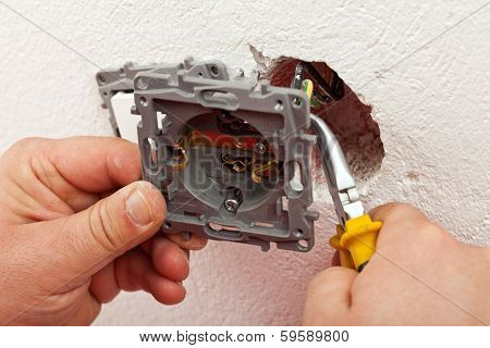 Electrician Connecting Electric Wall Fixture To The Wires