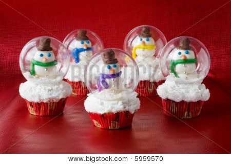 Snow globe cupcakes with snowman inside