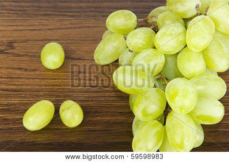 Green Grapes On Oak Shelf
