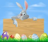 stock photo of hare  - An illustration of the Easter bunny and wooden sign with Easter eggs - JPG