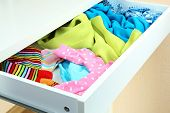 Open drawer with clothes close up
