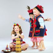 image of national costume  - Smiling kids wearing national costume - JPG
