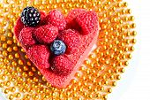pic of hackney  - Heart shaped cake with berries on top and with a gold beads - JPG
