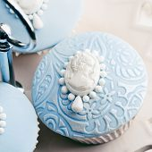 stock photo of cameos  - Cupcakes decorated with white sugar cameos - JPG
