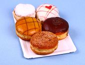 Five Delicious, Assorted Donuts On Plate