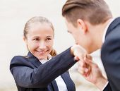 image of politeness  - Young businessman greet polite his partner with kissing hand - JPG