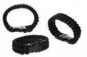stock photo of paracord  - Genuine Black Para shoot Cord Survival Bracelets - JPG