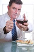 man at restaurant with red wine