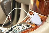 stock photo of cigarette lighter  - USB adapter converter plug with charging cable on a car - JPG
