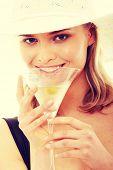 stock photo of hottie  - Summer girl drinking martini - JPG