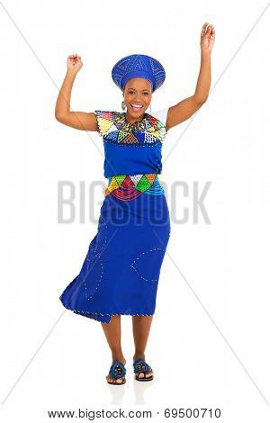 happy young african zulu woman dancing on white background