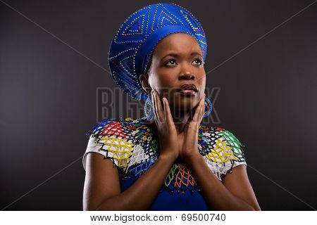 thoughtful african zulu woman looking up isolated on black background