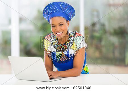 modern african zulu woman with laptop computer at home