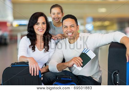 beautiful family at airport before boarding