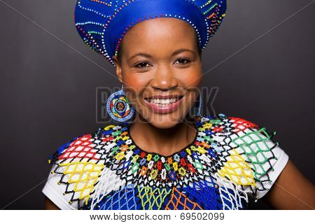 close up portrait of african zulu girl wearing traditional attire