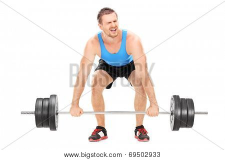 Bodybuilder struggling to lift a barbell isolated on white background