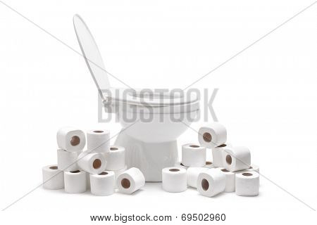 Many toilet paper rolls around a toilet bowl isolated on white background