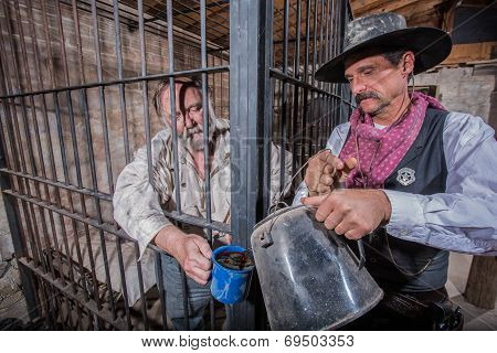 Sheriff Tends To Prisoner