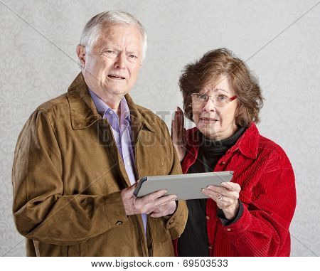 Confused Adults With Tablet