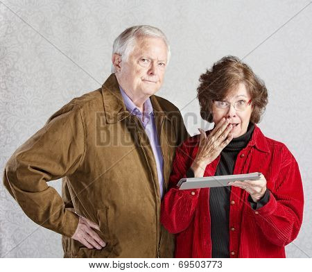 Embarrassed Woman With Tablet
