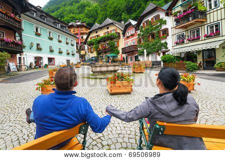 Couple on holidays in romantic Hallstatt town, Austria