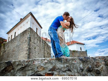 guy kissing the girlfriend against the old lock