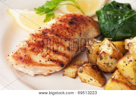 Grilled chicken breast with roasted potato and chard