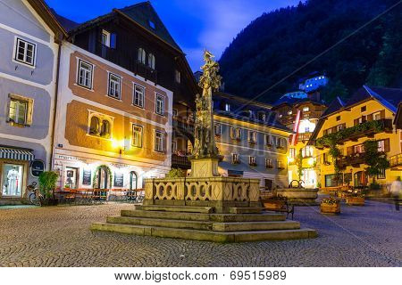 HALLSTATT, AUSTRIA - 20 JUNE 2014: Streets of Hallstatt at dusk, Austria. Hallstatt is historical village located in Austrian Alps at the Hallstatter lake and promoted by UNESCO World Heritage region.