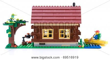 Ankara, Turkey - April 15, 2012: Lego Creator - Log Cabin is a 3 in 1 countryside houses isolated on white background