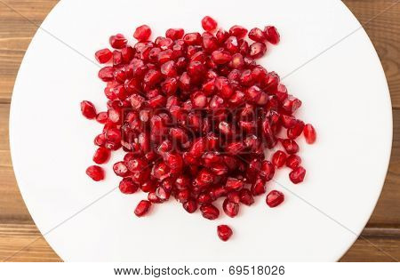Macro photo of small and fresh pomegranate seeds