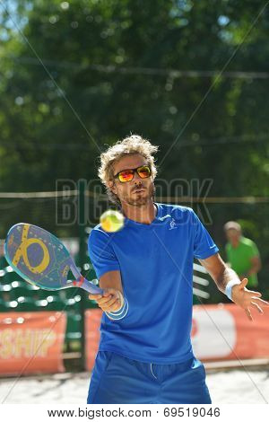 MOSCOW, RUSSIA - JULY 20, 2014: Alessandro Calbucci of Italy in the final match against Brazil during ITF Beach Tennis World Team Championship. Italy won 2-0