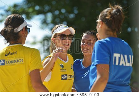 MOSCOW, RUSSIA - JULY 20, 2014: Women's doubles of Brazil and Italy after the final match of ITF Beach Tennis World Team Championship. Italy won in two sets